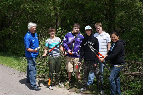 Helping the local community and the city by helping to clean up Buck Thorn.