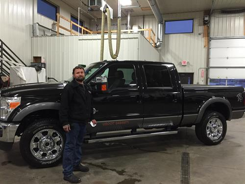 Jason Kellis standing proud by his new truck after the Interior & Exterior Clean.