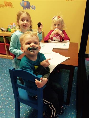 Mike & Sarah's Kiddos Enjoying Cupcakes at the Shop!