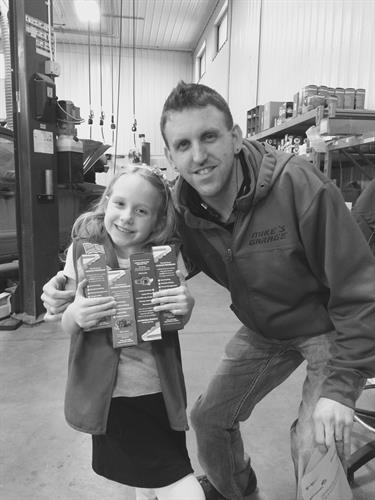 Owner Mike and his daughter Savana. Helping her selling her 1st ever girl scout cookies!