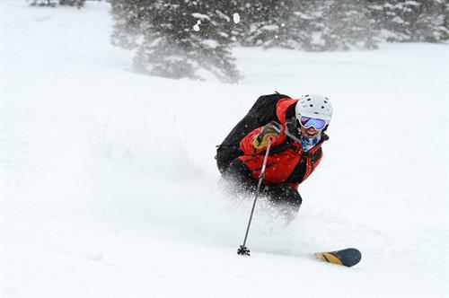Snow cat powder skiing