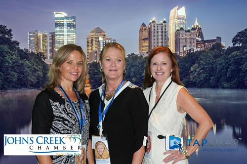 JCC Business Expo with Atlanta green screen background and branding