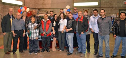 Our 1st Recycled Rides (2011) Gifting with Recipient and his family and the CARSTAR team.