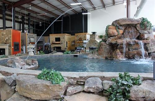 Showroom Centerpiece - large pool complete with waterffall and multiple fountains