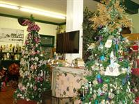 The entrance to our year-round Christmas area is adorned with a tv - sports on the screen every weekend!