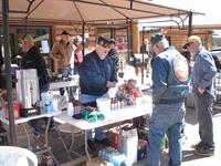 VFW cooks up some burgers in front of the store.