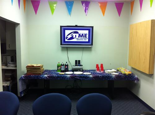 Conference room prepped for a new hire class graduation