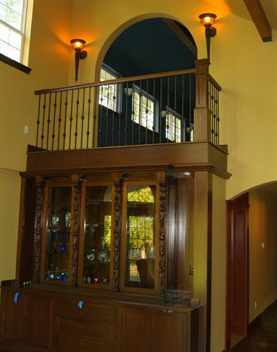 Interior balcony with custom cabinetry