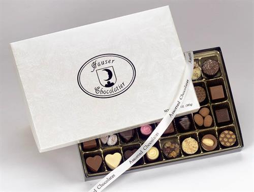 Premium Assorted Chocolates containing premium nuts, fruit filling and natural flavors in pure cocoa butter chocolates.