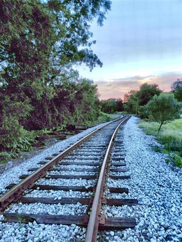 Railroad tracks wind into summer sunset near downtown Ocoee