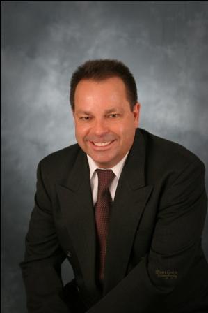 Mark D. Holmes, Principal