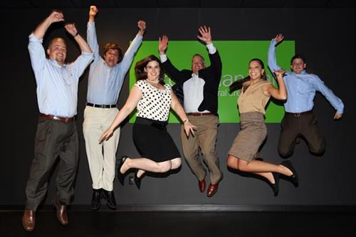 Team members jumping for joy!