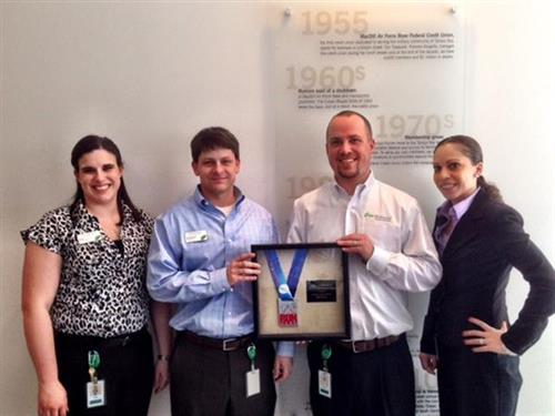 The Sandhill team received a great medal as sponsor of the Columbia Run Hard Marathon.