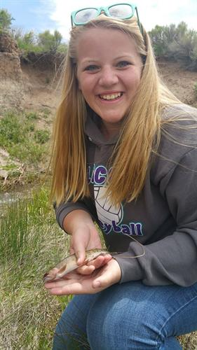Janae Neff is the project lead for the Red Creek Habitat Improvement Project. Here she is holding her first Colorado River cutthroat trout that she caught on Red Creek.