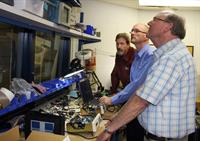 Byron Johnson (LBA), Josh McIntyre (Trewmac), and Marcian Bouchard (LBA) look at calibration features of the new TE-3000 impedance analyser in the LBA lab.