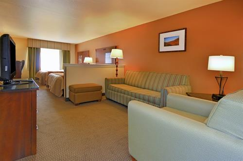 Suite room with seperate sitting area and 2 televisions