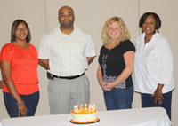 Navigators and VP of Cancer Control celebrate serving our 1000th patient through the Community Cancer Screening Program TM