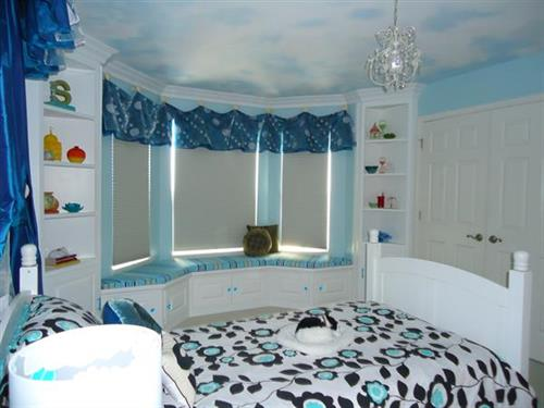 Girl's Bedroom with custom window seat, cabinetry, window treatments, and more.