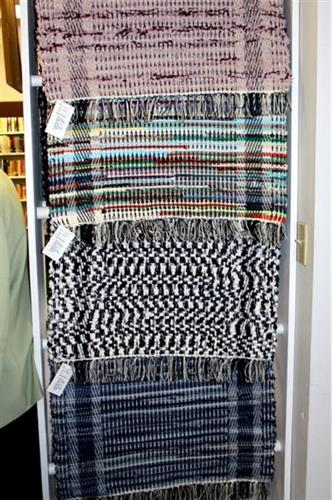 Rugs made on store's loom