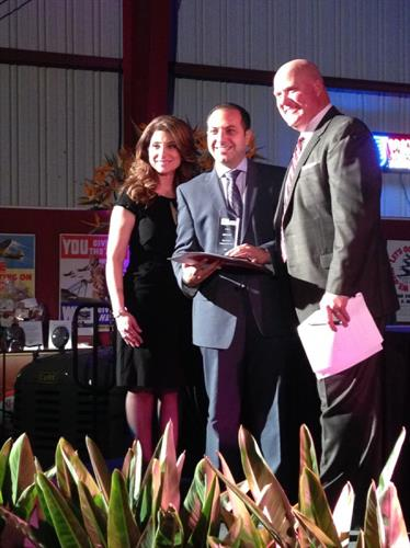 Principal attorney Ronson J. Shamoun and Chief Marketing Officer Renae Arabo accept the 2013 East County Business of the Year award from the San Diego East County Chamber of Commerce.