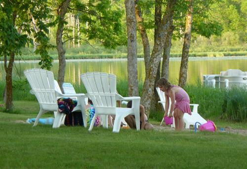 Playing on resort grounds close to the beach, quiet evening on the lake.