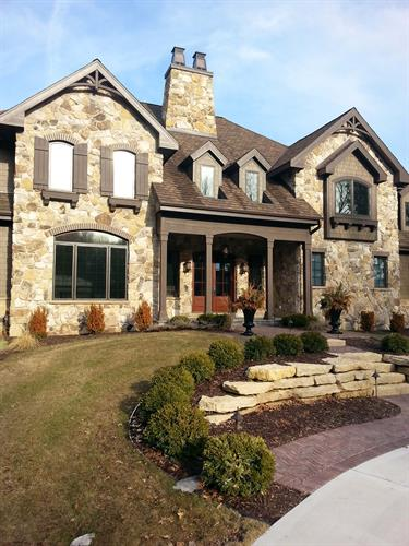 Lake home with natural stone