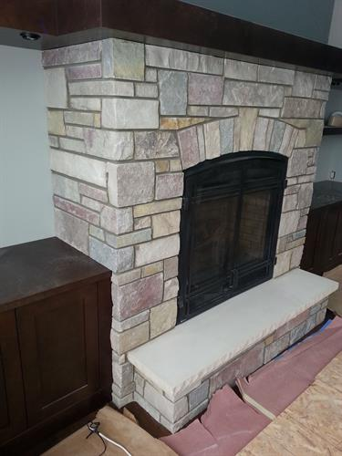 (5) different kinds of natural stone blended on fireplace