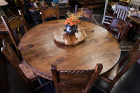 round solid wood table with turquoise inlay