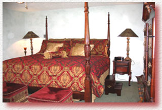 The elegantly furnished and spacious bedroom contains a four poster bed & tv.