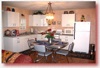 A fully equipped kitchen and cupboards filled with all your dining needs awaits you.