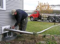 Bulk pellet delivery in action - the driver attaches a pneumatic hose to permanent piping connected to storage containers in your basement or garage and quickly fills the containers.