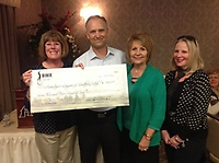 SkyWest and Dixie Classic presented a check for $7500 to President, Martha Heuer.