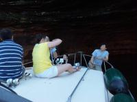 On the bow of the Rob Roy going into the sea caves