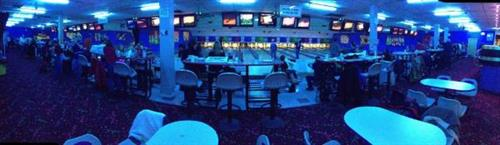 Cosmic bowling.  Bowl under flashing glow in the dark lights.
