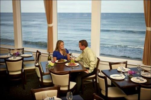 Along the front windows, tables are literally over the ocean.