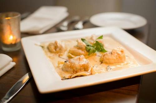 Our hand-made ravioli with pasta made fresh in-house and lots of filling.