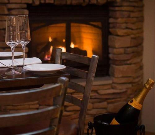 Cozy, intimate seating by our fireplace.