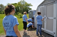Globe Staff painting shed for Annual Community Service Day