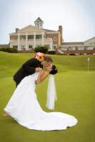 Gallery Image Bride%20and%20Groom%20Kissing%20on%20Golf%20Course.jpg