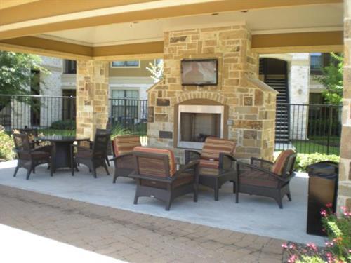 Pool area, two flatscreens and a cozy fireplace