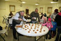 Kiwanis serving cider and donuts at VFW during christmas tree lighting