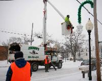 Linden Kiwanis putting up Christmas decorations with Ronald's Tree Service.