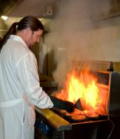 Technician performing a test on a griddle