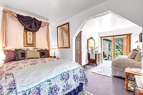 The Garden Suite, private garden deck, electric fireplace, featherbeds, old-style tub in its private bathroom.