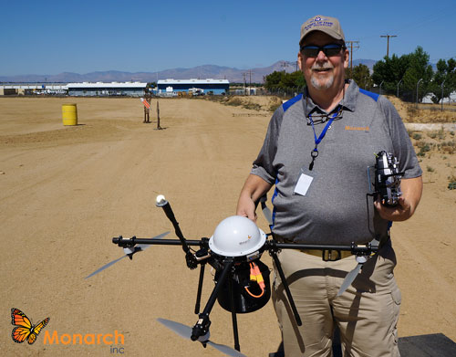 Monarch pilot Scott Brown holding a Monarach UAS at the First Annual Drone Festival, May 9, 2015, at the Desert Empire Fairgrounds, Ridgecrest.