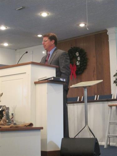 Jim preaching at a local Baptist church