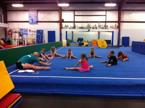 Gymnastics class starting by stretching.