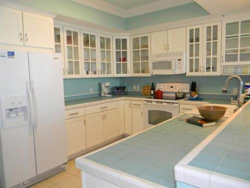 Fully equipped kitchens waiting for your family to enjoy meals together on their Navarre Beach Vacation.