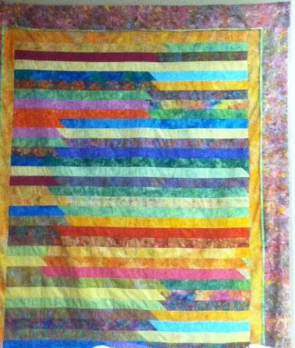 Easy quilt made from a bali pop (2 1/2''  batik ) and a few  borders. Pattern free with the purchase or a  jelly roll or bali pop.