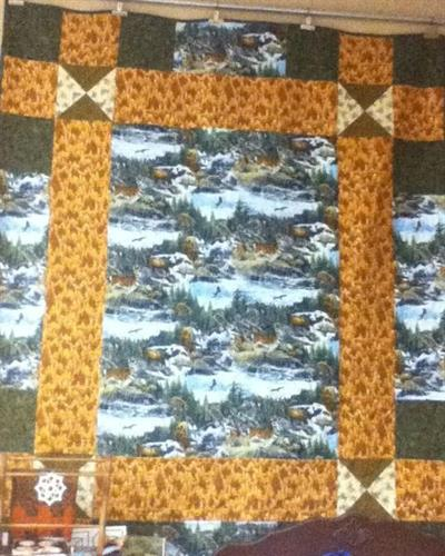 WIld life fabrics in  cottons and flannel cotton. (pattern from  Thimbleberries.)
